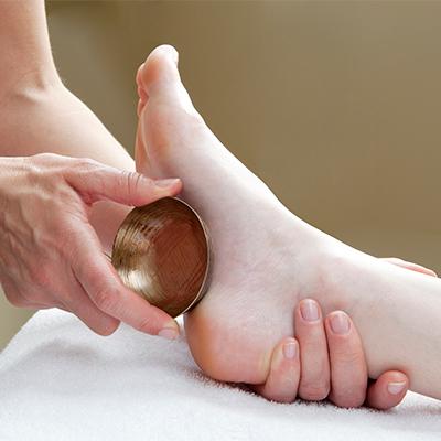 Massage des pieds au bol kansu